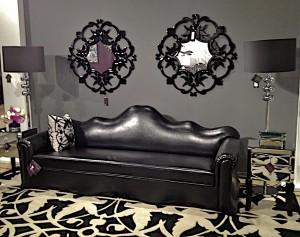 Priscilla Presley Home black leather sofa